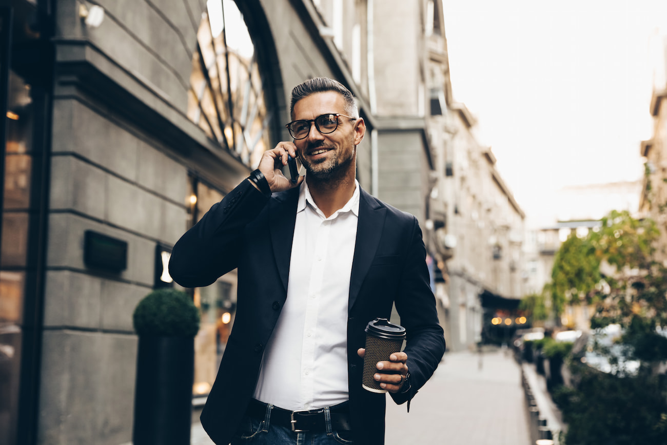 Businessman on phone with coffee