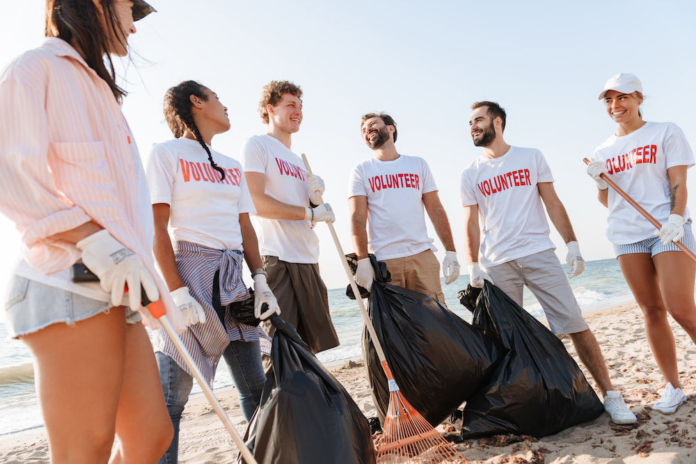 Image of volunteers cleaning up a beach