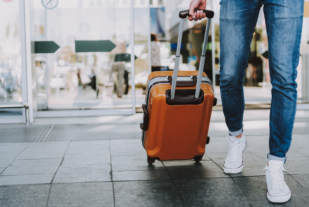 Image of a man with a suitcase