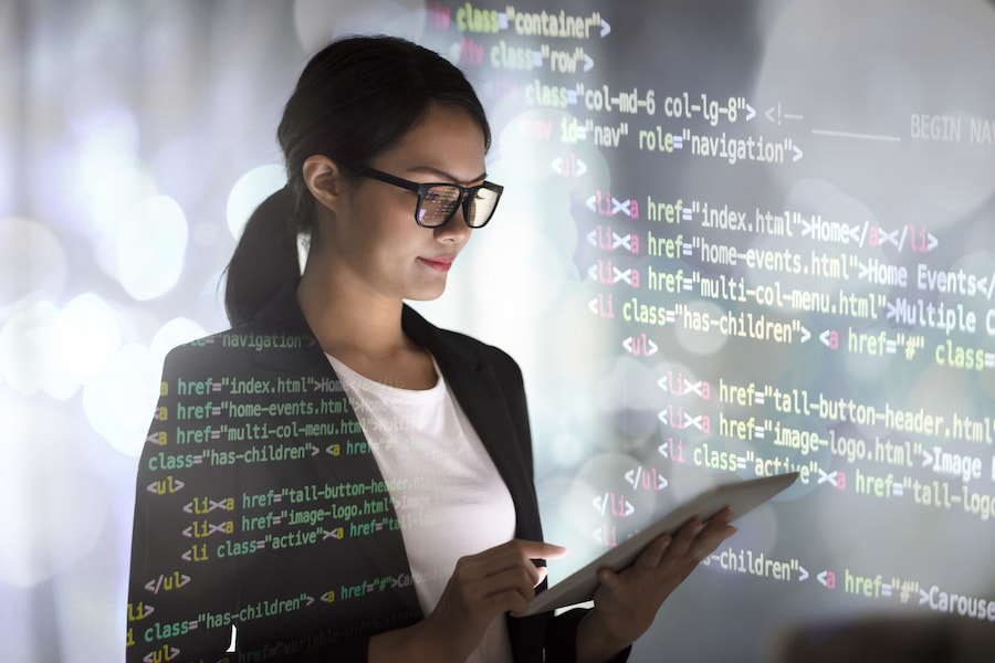 Image of an asian woman on a computer