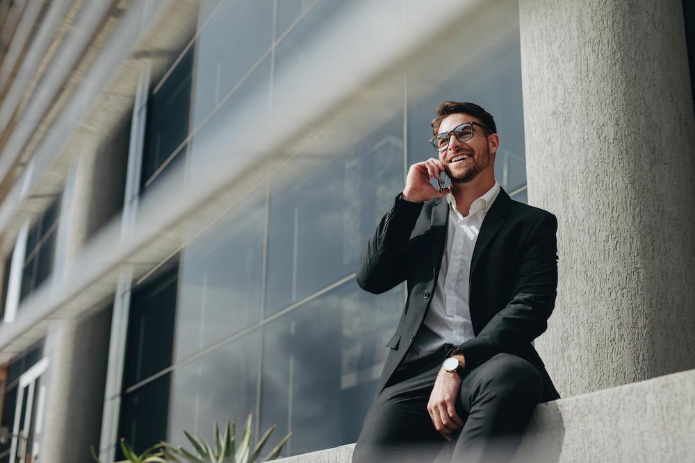 Businessman on phone outside
