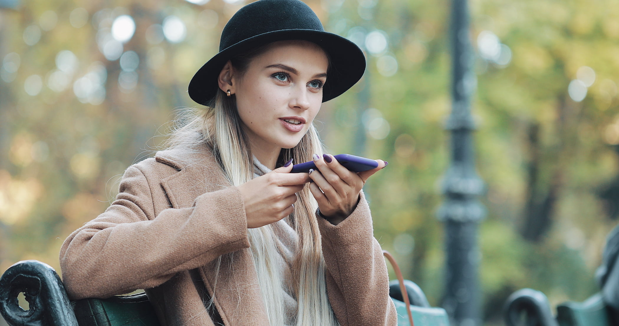 Image of a woman talking into her phone