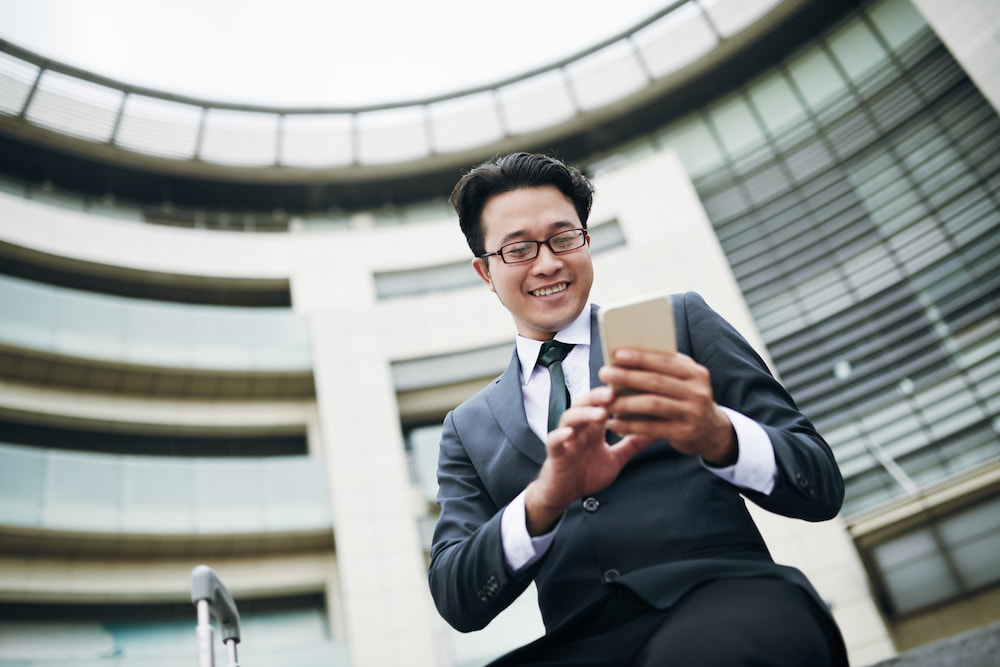 Image of an Asian man on his phone