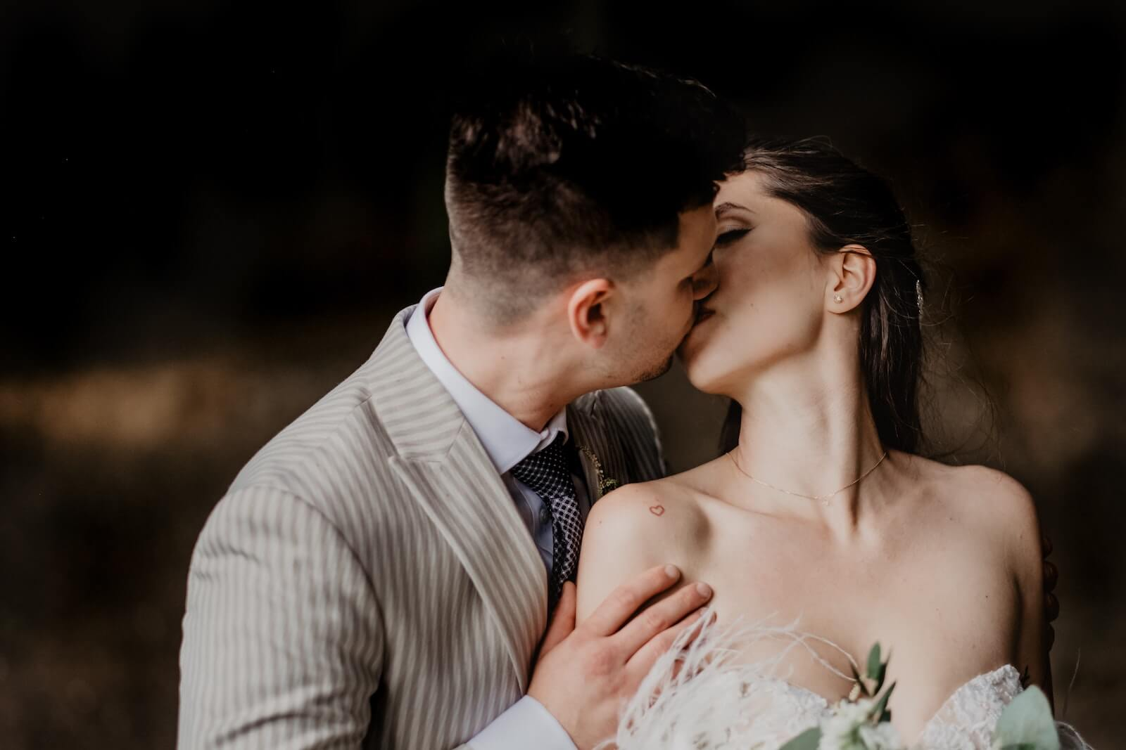 A couple sharing a beautiful kiss for their wedding video