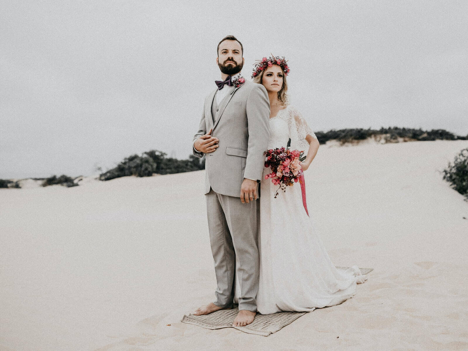 Couple poses for Wedding Film.