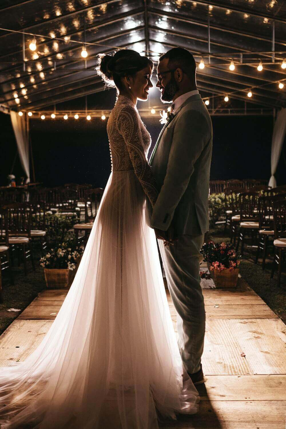 Couple having an intimate moment in their wedding hall.