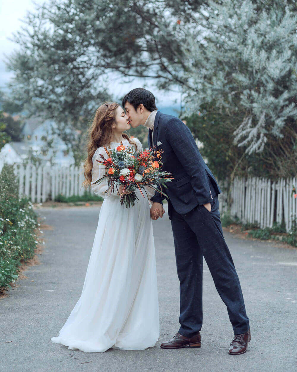 Couple Holds Each Other Tight for Wedding Film.