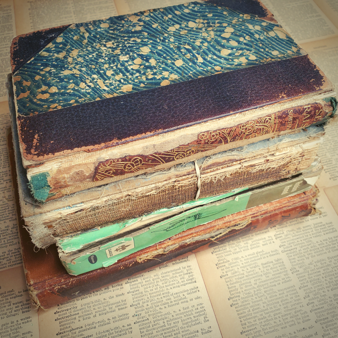A stack of books that are falling apart and really old.