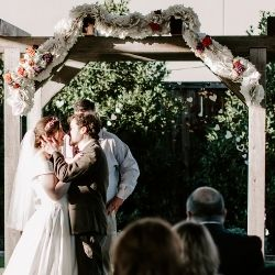 Wedding alter with book page garland draped over top
