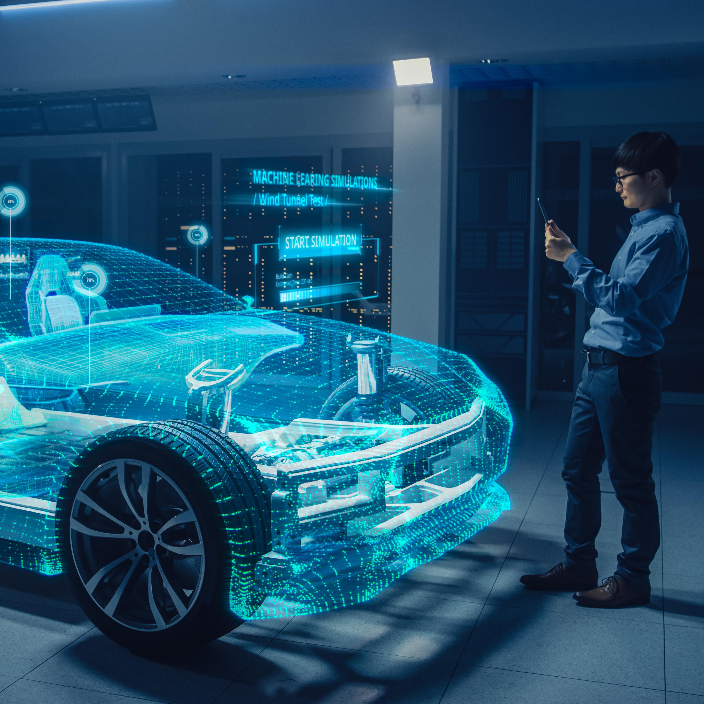 Ein Mann der vor einem 3D Auto steht