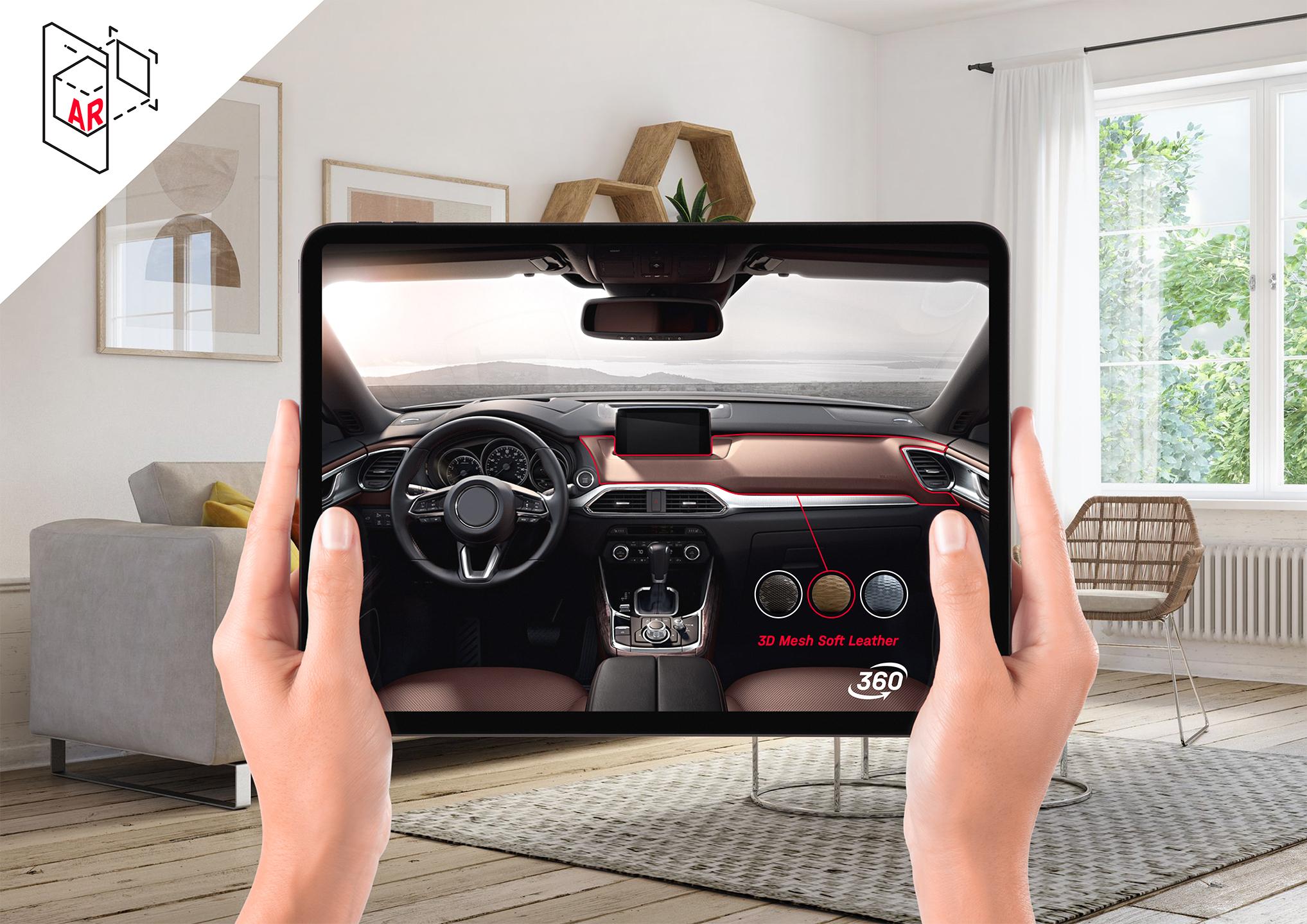 Tablet mit einer AR Anwendung. Damit kann interaktiv die Innenausstattung eines Autos personalisiert werden.