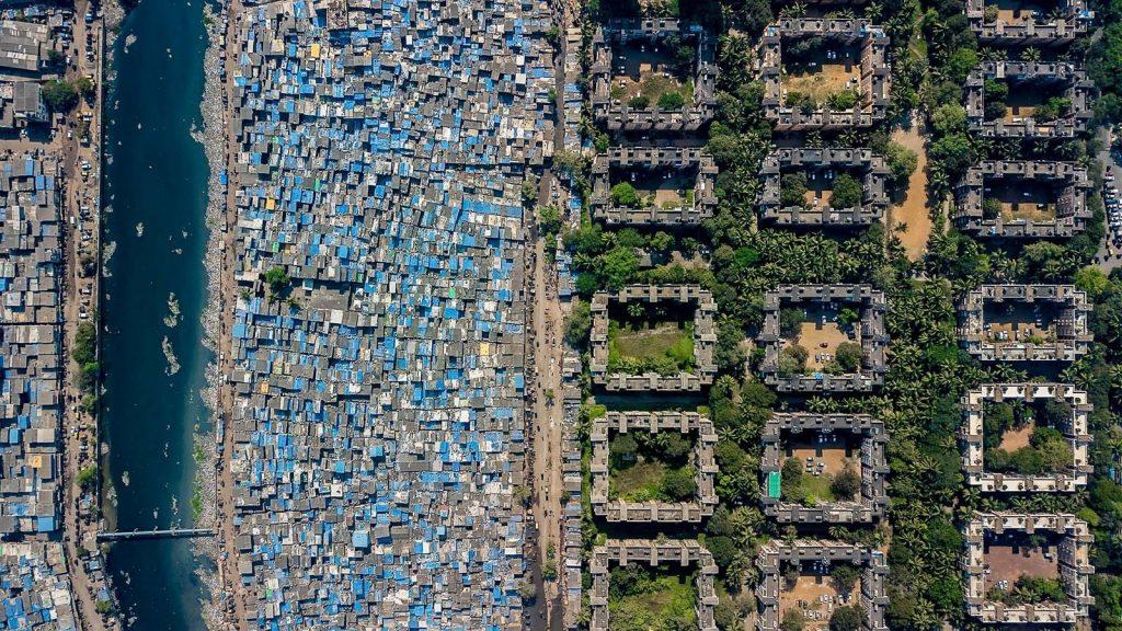 A slum lines the Mithi River, India