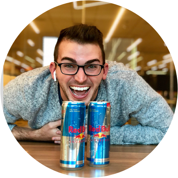 Cody Hebert profile photo smiling in front of redbull cans