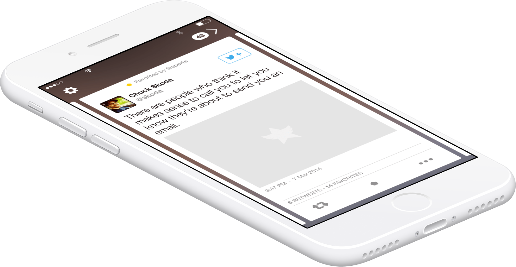 An iPhone laying on its back showing an app with a card-like interface for a tweet.