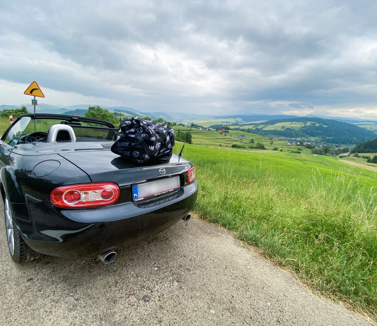 A photo of a landscape in Poland with X-Team bag and my car.