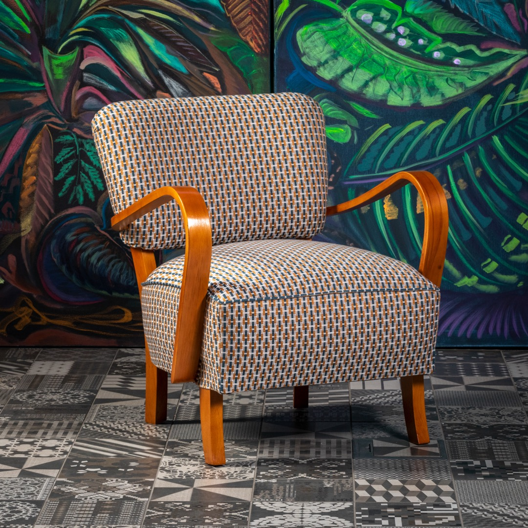 Art Deco cocktail armchair, 1930s. Completely restored. Armrests solid beech, upholstery material Tikal, Habanera, Romo. Classic spring binding in the seat. Very comfortable smaller seating. We have a pair in stock.