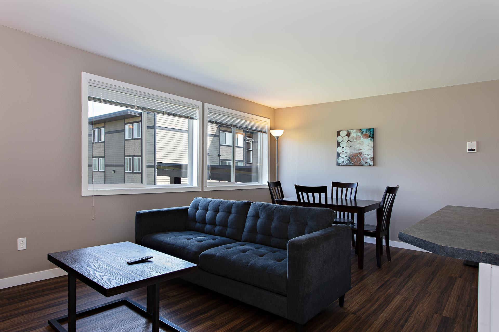 Furnished living room and dining room at Hillcrest Place Apartments in Kitimat, B.C.