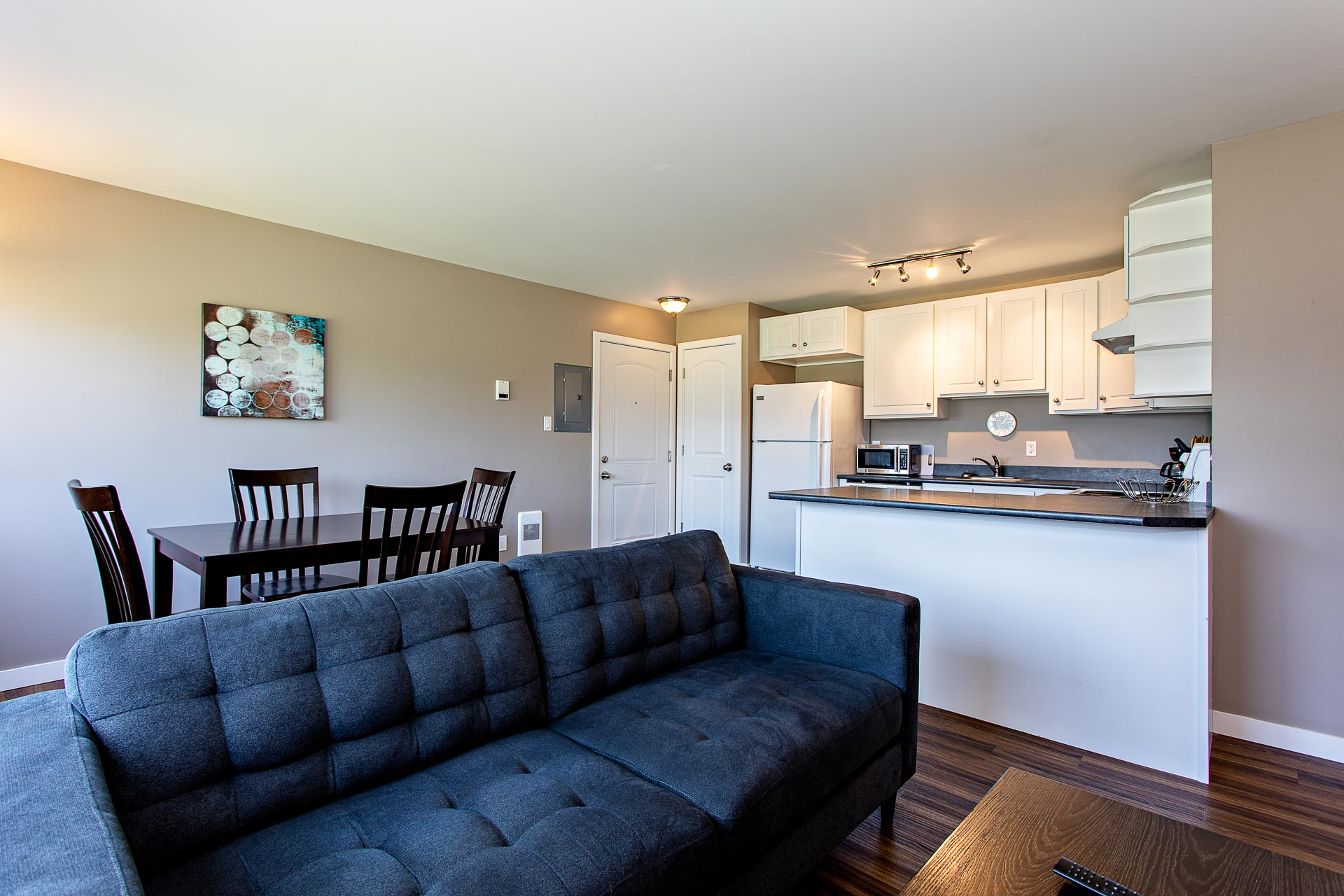 Furnished living room, dining room, and kitchen at Hillcrest Place Apartments in Kitimat, B.C.