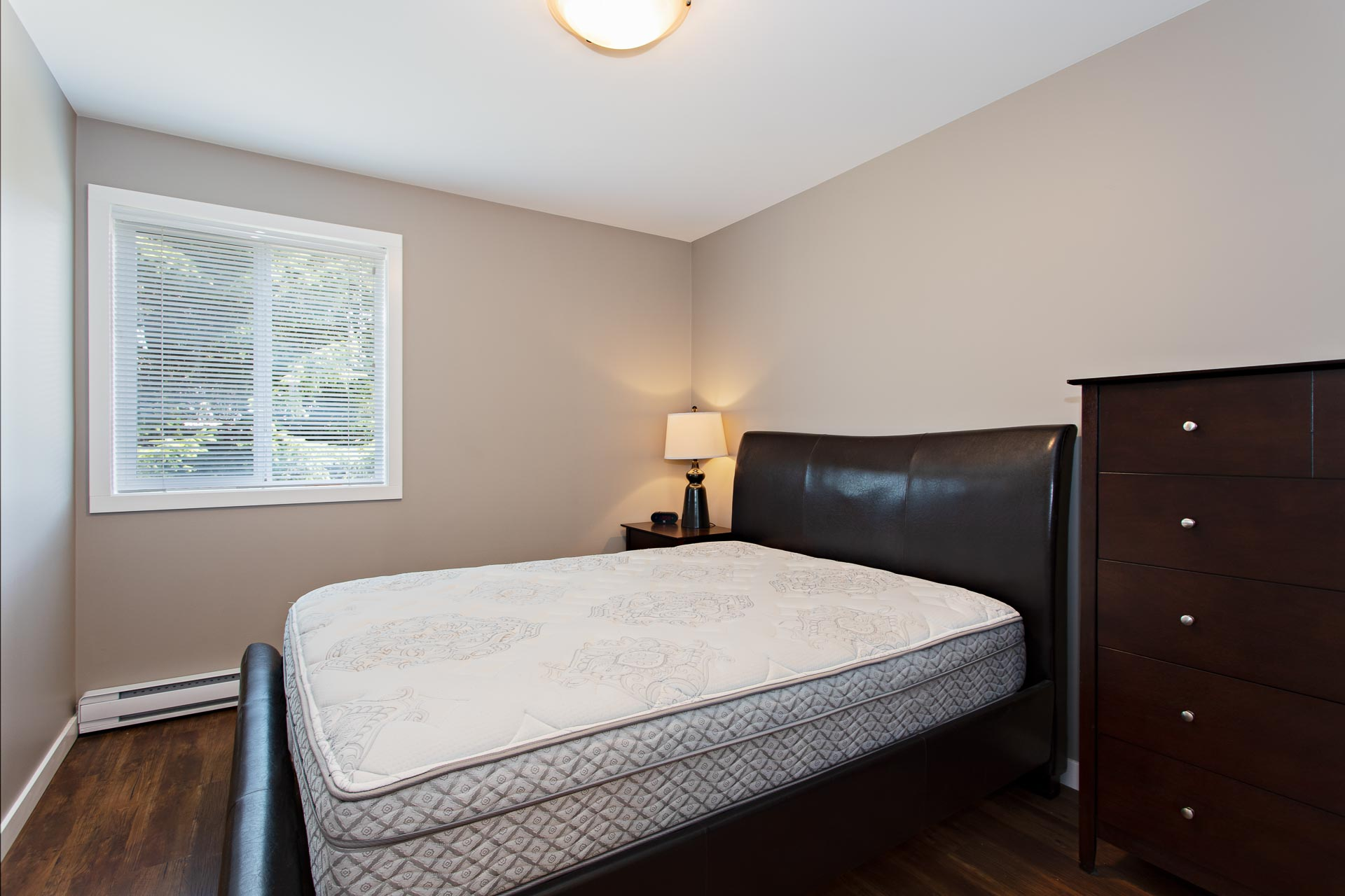 Furnished bedroom at Hillcrest Place Apartments in Kitimat, B.C.