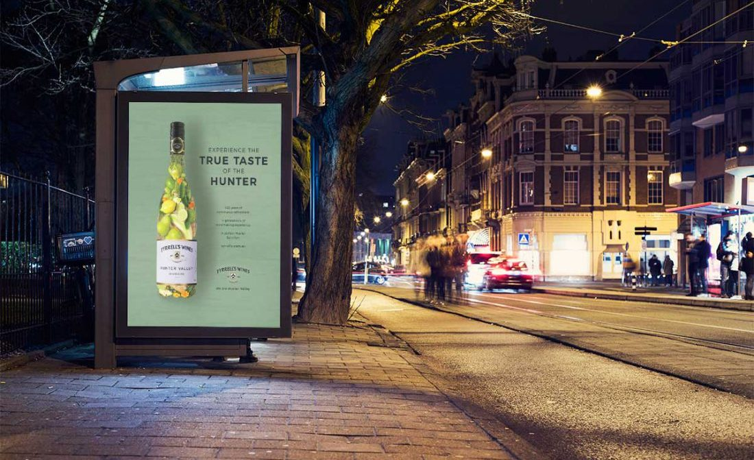 A bus stop advertisement with a wine bottle laid out for Tyrrell's Wines. The wine bottle is made up of organic fruit and herbs, portraying the wine's flavour profile.