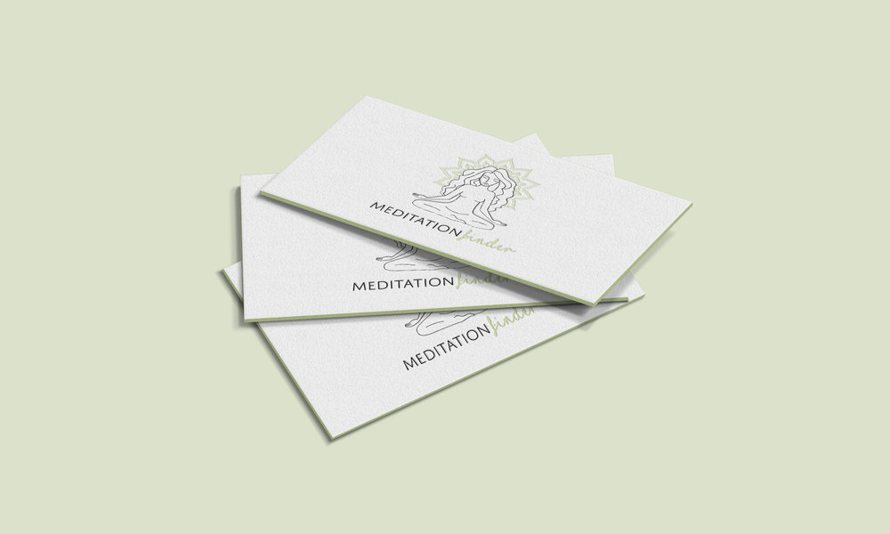 Business cards for Meditation Finder, featuring the logo in teh center of the card.