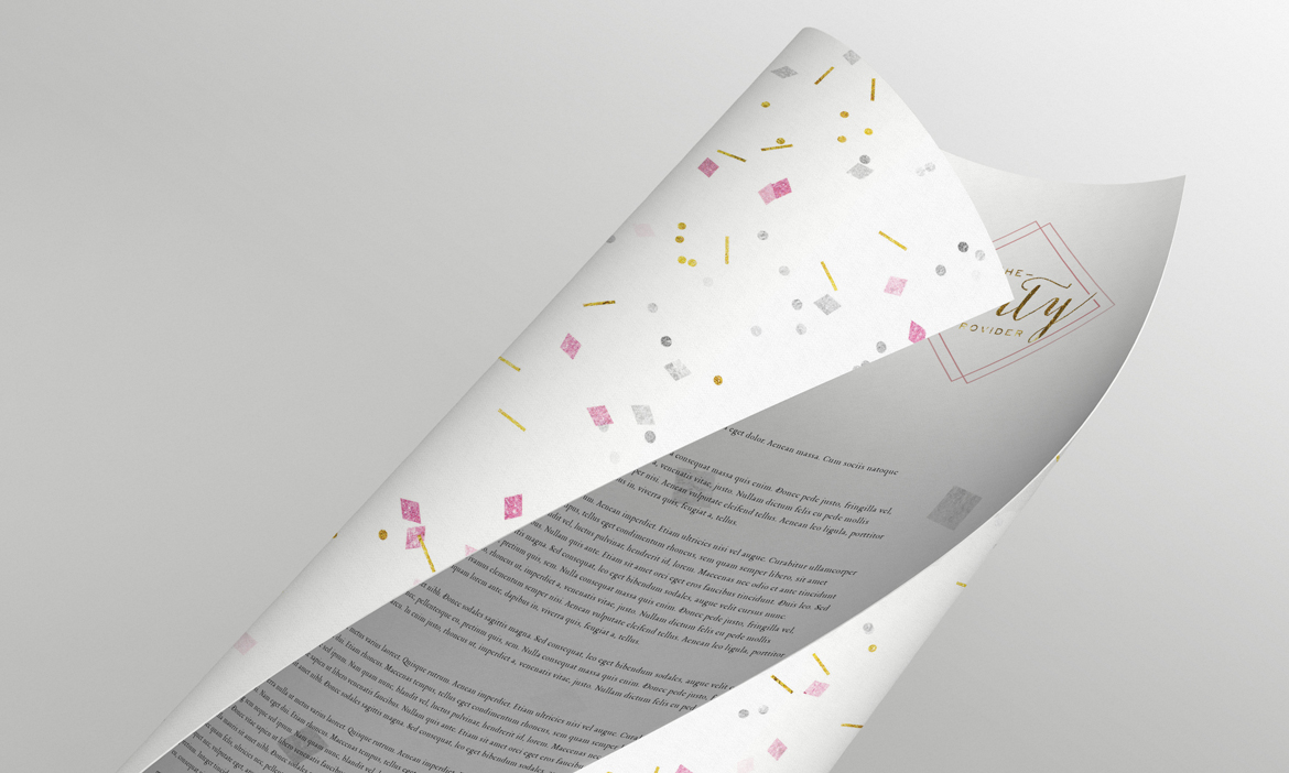A letterhead for The Party Provider, with the back side covered in glitter and confetti.