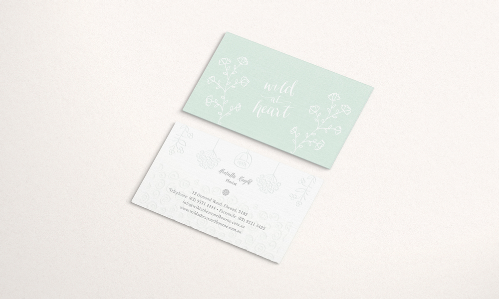Embossed Wild at Heart business card designs, featuring botanical illustrations.