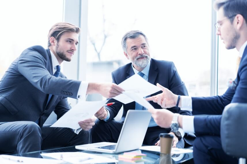 Three men discuss business