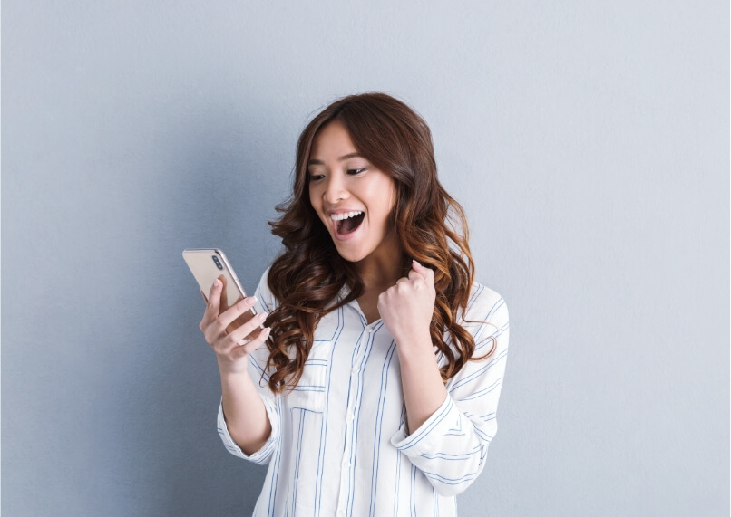 Lady looks happy looking at her phone