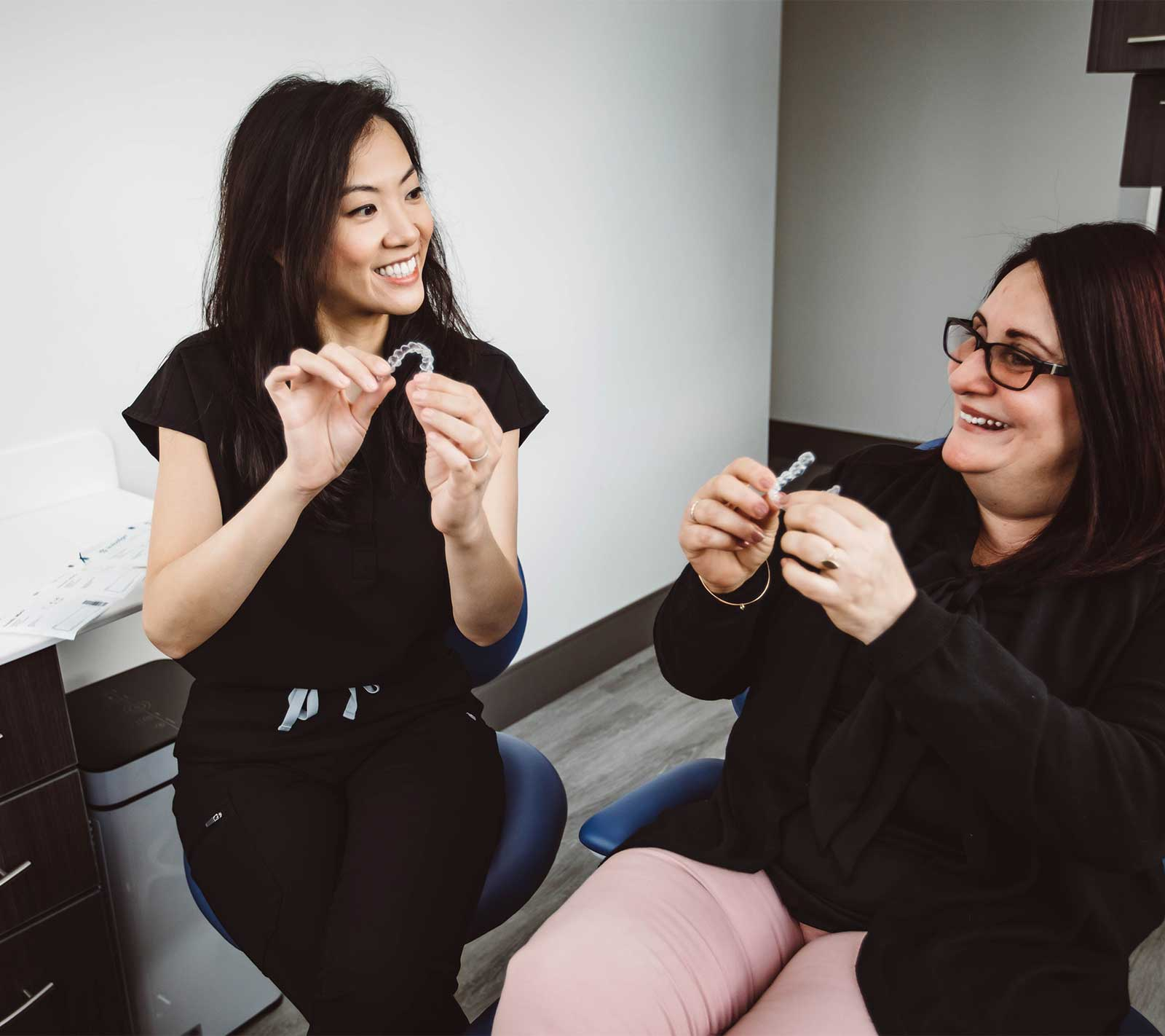 Photo of Miami orthodontist Patricia Hong holding an Invisalign clear aligner