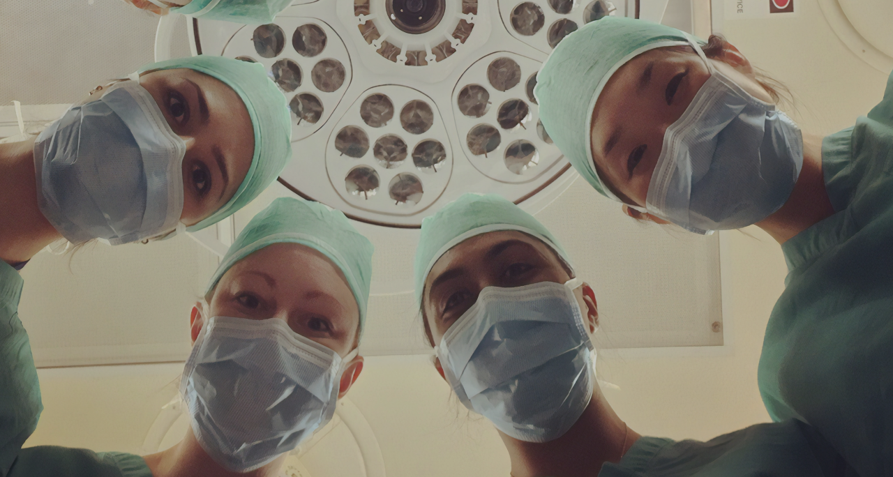 Image of nurses looking at patient