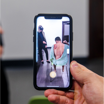 Image of a phone screen showing how the AR looks like on the headset