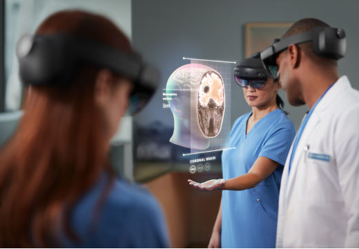 Doctors and nurses using AR headsets and models ot plan surgery and image patients
