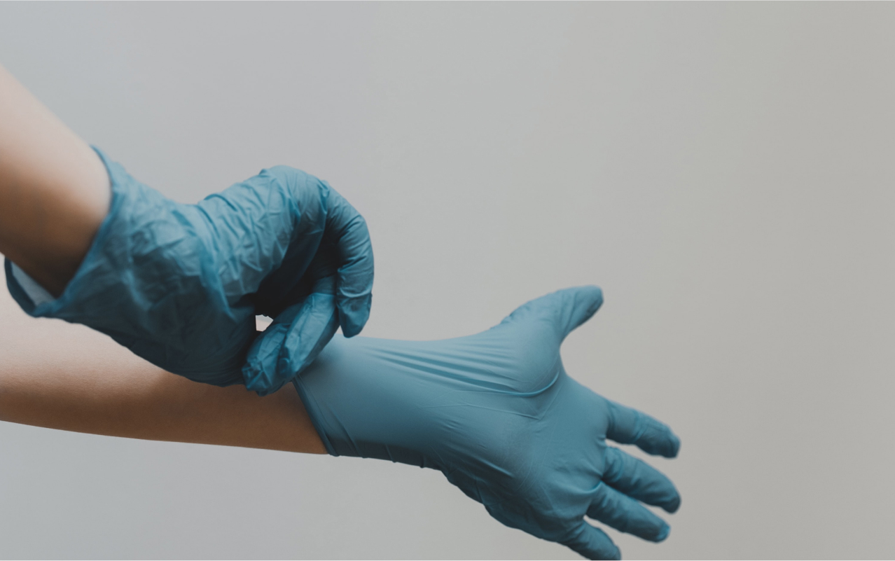 Image of a person wearing latex gloves