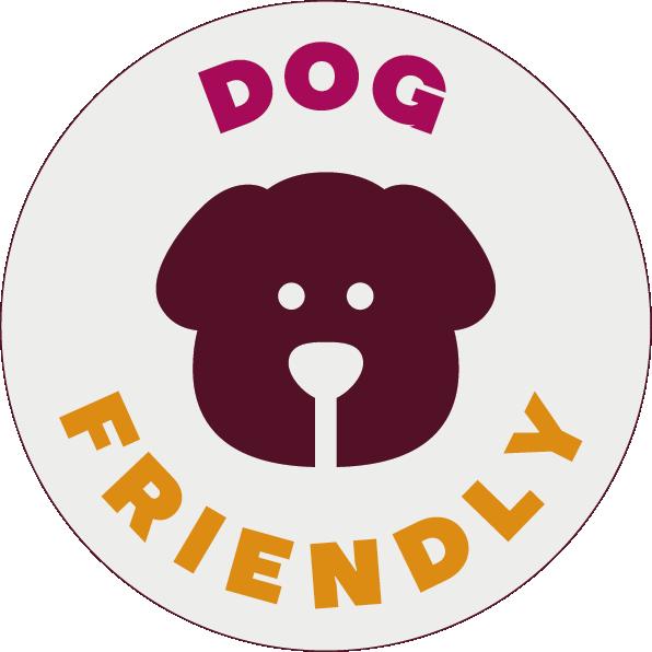 "Round sticker with a dog icon, saying ""Dog Friendly""."