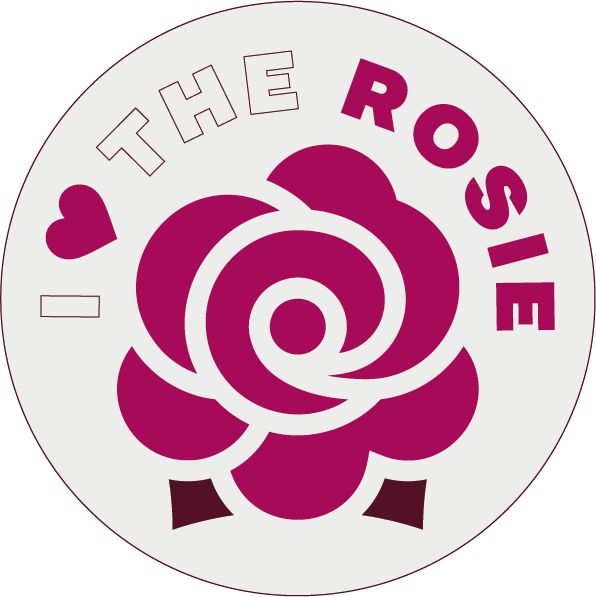 """Round sticker with a rose icon, saying """"I love the Rosie""""."""