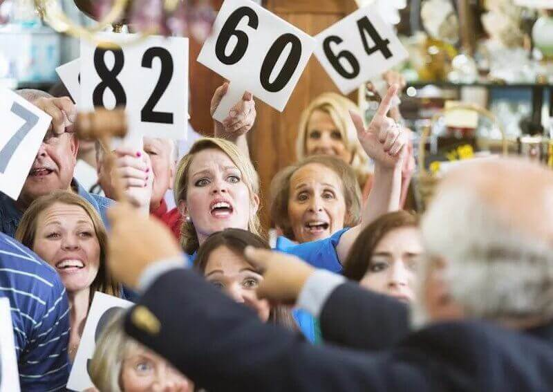 Image of bidders in a traditional auction