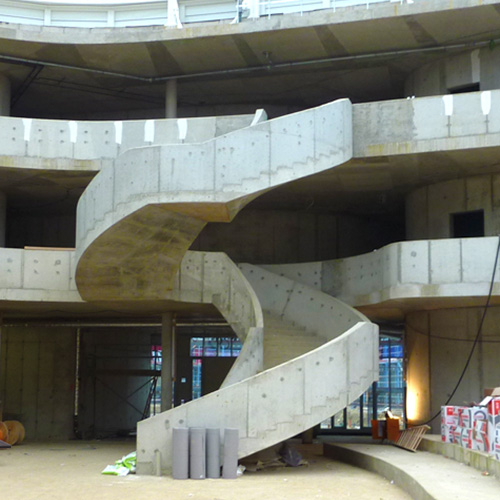 Internal construction area of large school foyer showing concrete formed staircase requiring timber cladding, thumbnail image.