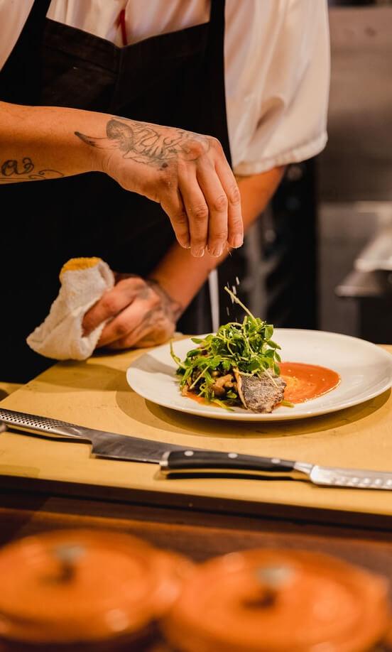 a chef preparing a dish