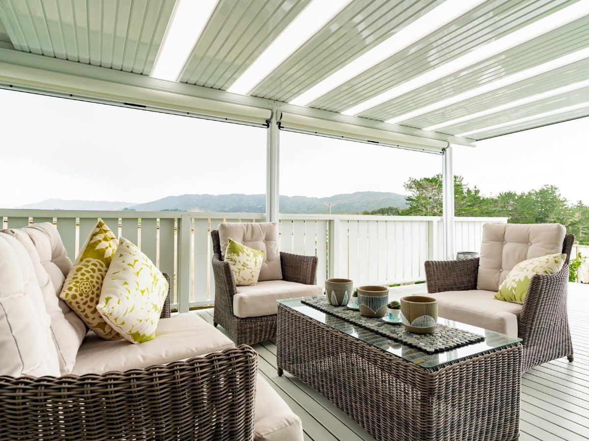 Stunning outdoor space covered by flat roof and enclosed with Ziptrak outdoor blinds. Outdoor lounge to fill the space.