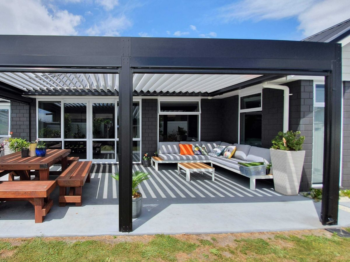 Black louvre with white blades covering outdoor furniture