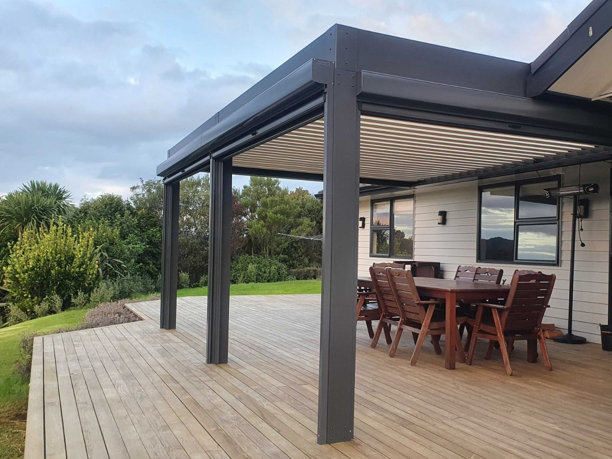 Louvre roof covering outdoor dining set with beautiful view