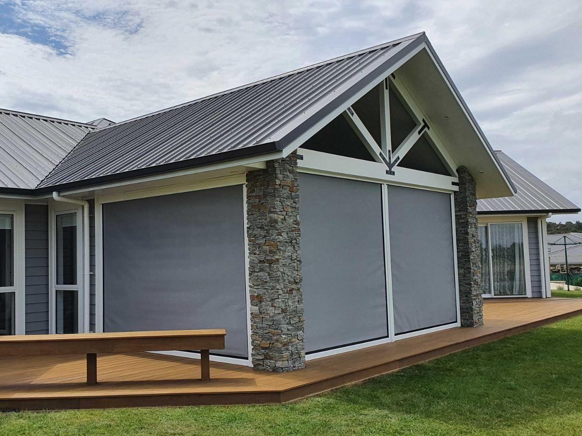 Four outdoor blinds enclosing portico area