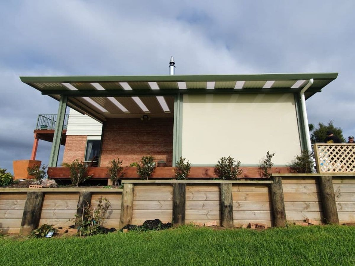 Two blinds with one open and one closed against custom coloured flat roof