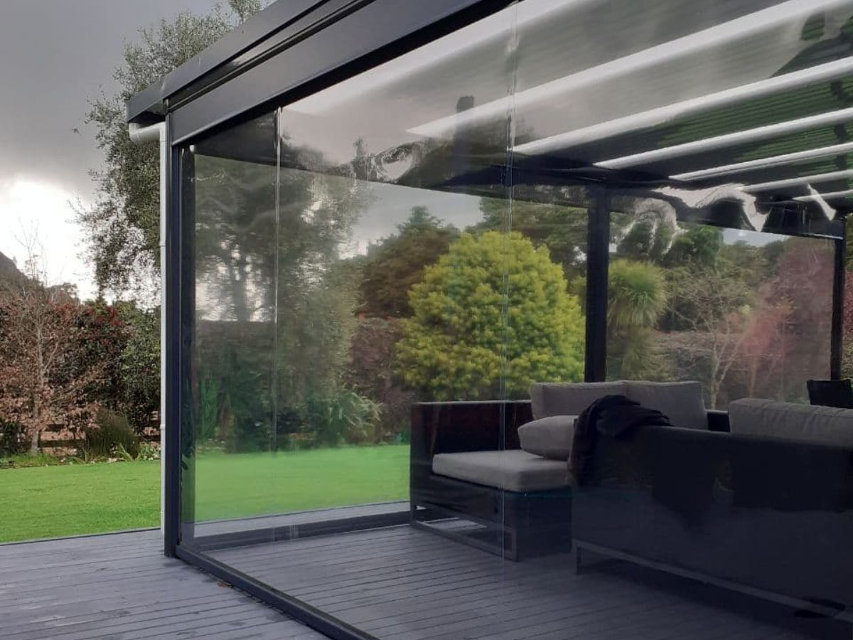 PVC blinds enclosing outdoor lounge with flat roof