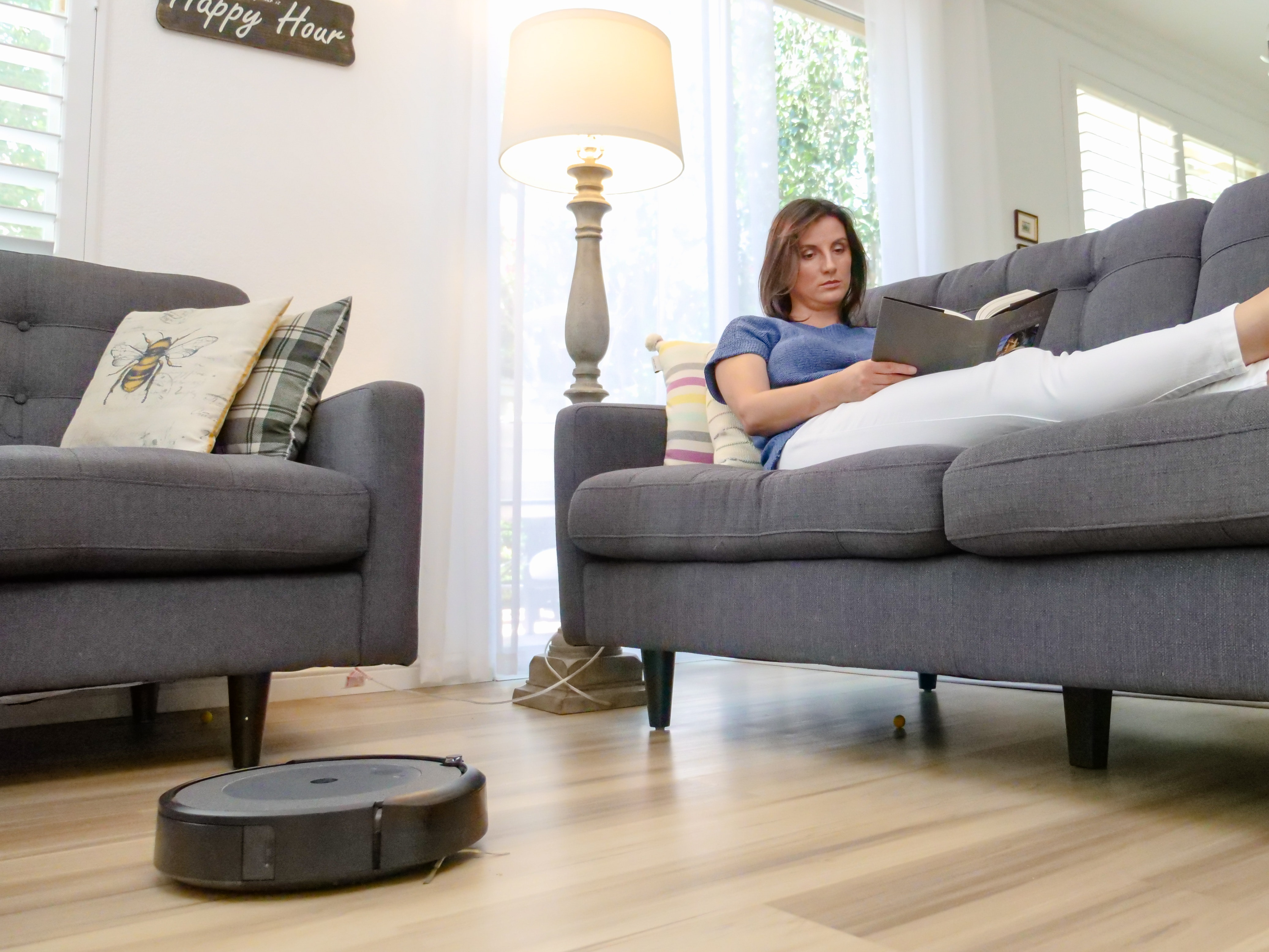 A robot vacuum cleaner cleaning the room