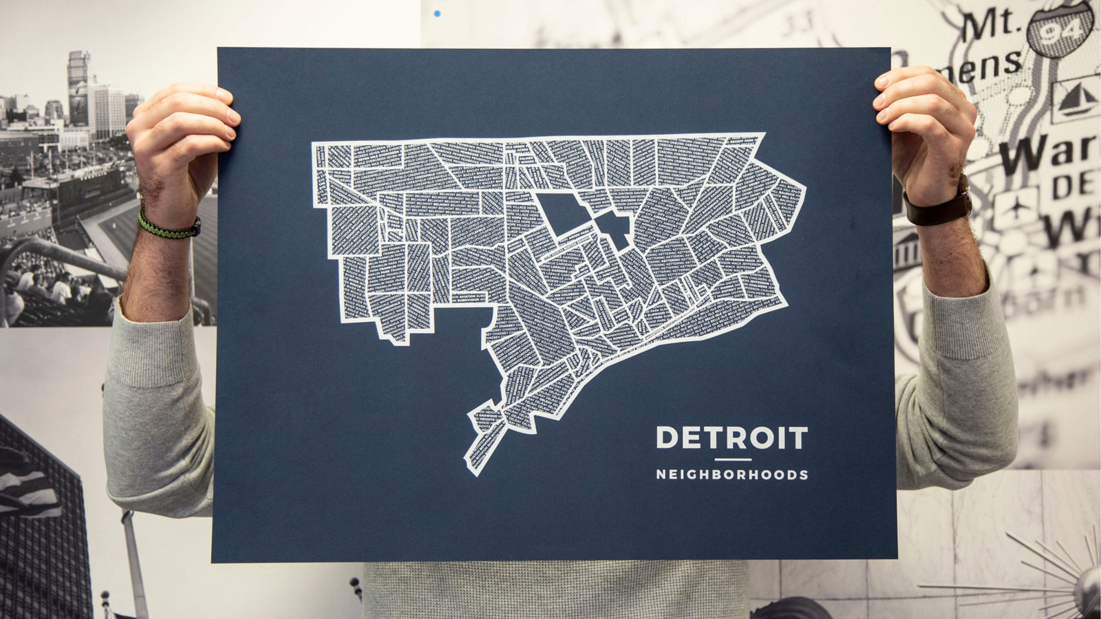 Me holding up my white on dark blue Detroit neighborhood print.