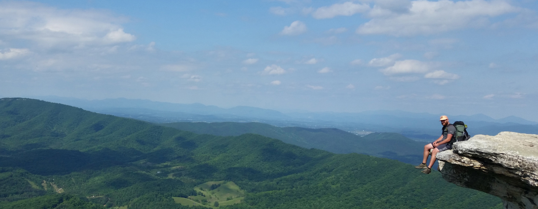 Me sitting on the edge of McAfee Knob in Catawba, Virginia.