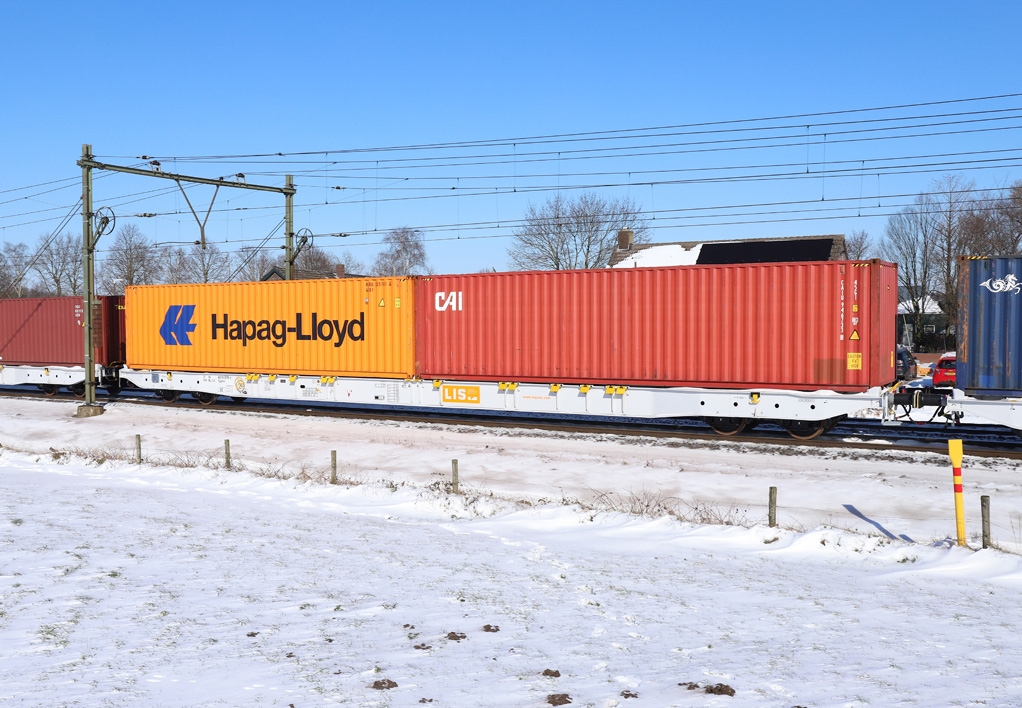 LIS train wagons passing by, carrying partner containers from a to b on a MMR purchased rail project