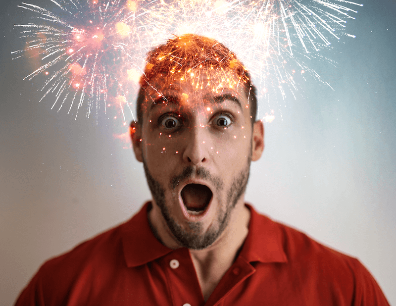 Excited man with fireworks AR filter above his head